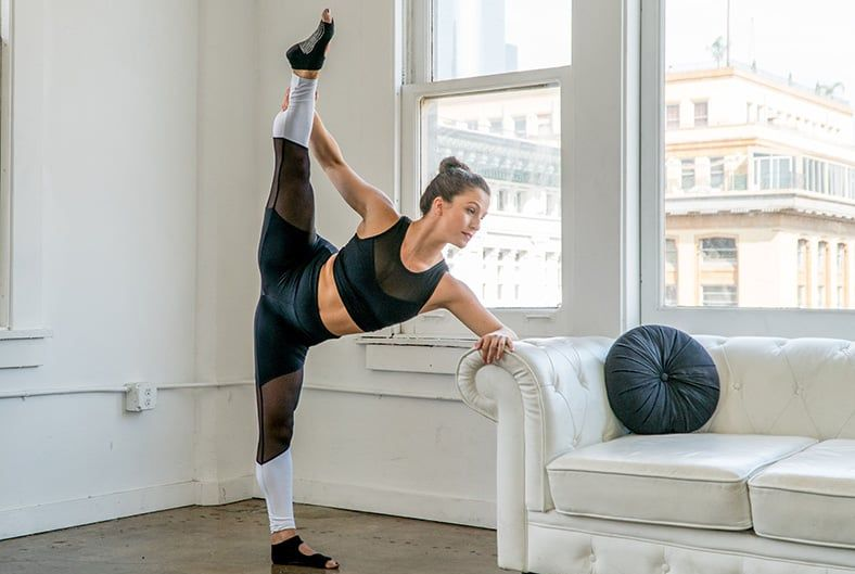 courtni stretching next to a couch